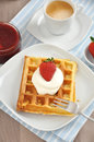 Waffles with cream and strawberries Stock Photography