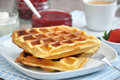 Waffles with cream and strawberries Royalty Free Stock Photo
