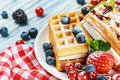 Waffles with fresh berries on the table Stock Photo