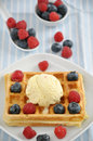 Waffles with ice cream and berries fresh topped vanilla fresh Stock Photos