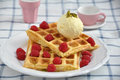 Waffles with ice cream and berries fresh topped vanilla fresh Stock Image