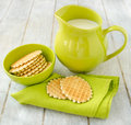 Waffles with jug of milk on a green napkin and in ceramic bowl on the old retro kitchen table Stock Images