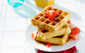 Waffles with strawberries Royalty Free Stock Image