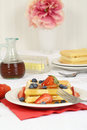 Waffles with strawberries blueberries and syrup Royalty Free Stock Photo