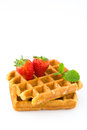 Waffles with strawberries isolated on white background Royalty Free Stock Photo
