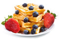 Waffles with strawberry and blueberry Stock Images