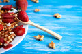 Waffles with strawberry on white plate on blue background. Royalty Free Stock Photo