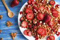 Waffles with strawberry on white plate on blue background. Top view flat lay Royalty Free Stock Photo