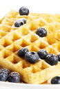Waffles with sugar covered blueberries and syrup Royalty Free Stock Photo