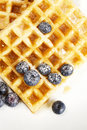 Waffles with sugar covered blueberries and syrup f Royalty Free Stock Photos