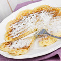 Waffles with sugar on white plate Royalty Free Stock Image