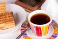 Waffles and tea cup of fresh on a plate in the morning on a white tablecloth Royalty Free Stock Image
