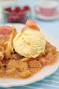 Waffles with vanilla ice cream and rhubarb compote Royalty Free Stock Images