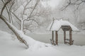 Wagner cove and gazebo in the snow central park nyc lovely wooden shelter by lake during a snowfall trees covered by winter peace Royalty Free Stock Photos