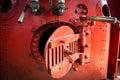Red engine room of steam locomotive