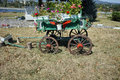 Wagon covered with flowers in the yard in Monastery St. John the Baptist, Kardzhali Royalty Free Stock Photo
