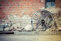 Wagon wheel background near the vintage wall Royalty Free Stock Photos