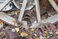 Wagon wheel discarded horse shoes pans pile this filthy outdoor junkyard holds treasures of chains tea pot bucket wash basin tin Stock Photos