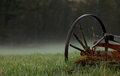 Wagon wheel in the mist a broken old morning Stock Images