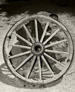 Wagon wheel old wooden against wall Stock Image
