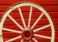 Wagon Wheel by Red Wall Royalty Free Stock Photo