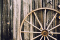 Wagon wheel retro a close up of a vintage lying up against a building partially in the frame filtered for a vintage look Royalty Free Stock Photos