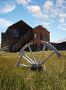 Wagon wheel in rural setting Royalty Free Stock Photo