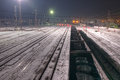 Wagons loaded with coal at the station are winter night Royalty Free Stock Photography