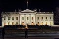 WAHINGTON, D.C. - JANUARY 09, 2014: White House at night. With Police Officer in foreground. Royalty Free Stock Photo