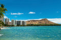 Waikiki beach with azure water in hawaii with diamond head background Royalty Free Stock Image