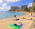 Waikiki beach hawaii people relax and enjoy the sun and ocean at honolulu Stock Images