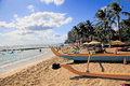 Waikiki beach hawaii people relax and enjoy the sun and ocean at honolulu outrigger canoe is seen in foreground Stock Photography