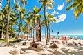 Waikiki beach in honolulu hawaii september tourists sunbathing on white sand shoreline is s Royalty Free Stock Photos