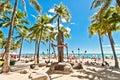Waikiki beach in honolulu hawaii september tourists sunbathing on white sand shoreline is s Stock Image