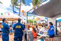 Waikiki beach market in honolulu hawaii hi usa september policemen tourists and locals white sand Stock Photo