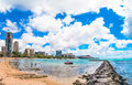 Waikiki beach with Pier and boats in Honolulu Royalty Free Stock Photo
