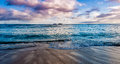 Waikiki beach at sunset ocean waves breaking on Royalty Free Stock Photo