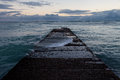 Waikiki breakwater water washing over a on famous beach in honolulu hawaii Stock Photo