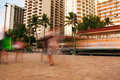 Waikiki streets blurred tourists and traffic of Royalty Free Stock Photo