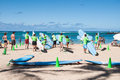 Waikiki surf lessons students observe native hawaiian instructor teach the way of the surfboard on beach hawaii Stock Images