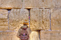 Wailing wall praying jerusalem israel man inserting notes at the Royalty Free Stock Photography