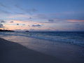 Waimanalo Beach looking towards Mokulua islands at dusk Royalty Free Stock Photo