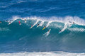 Waimea bay Oahu Hawaii, Surfers ride a big wave Royalty Free Stock Photo