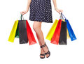 Waist down view of woman with shopping bags holding colorful isolated on white background Stock Image