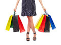 Waist down view of woman with shopping bags holding colorful isolated on white background Royalty Free Stock Photo