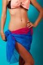 Waist girls in bikinis and sarongs Royalty Free Stock Photos