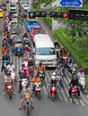 Wait for a green light bangkok august vehicles motorcycle car taxi and tricycle at rama road on august in bangkok thailand Stock Image