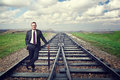 Wait my train smiling businessman on rail Royalty Free Stock Image