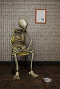 Waited too long illustration of a dead skeleton sitting on a chair can represent ironically a person who died waiting for Stock Images