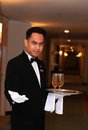 Waiter or butler photograph of at hotel corridor Royalty Free Stock Photo